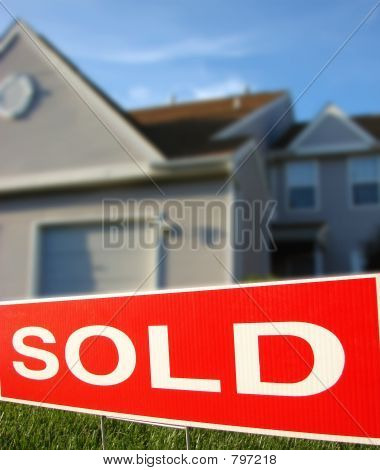 Real Estate Sold Sign & House