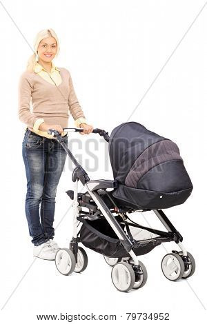 Full length portrait of a happy young mother pushing a baby stroller isolated on white background