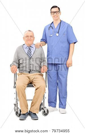 Full length portrait of a male nurse and a senior in wheelchair posing isolated on white background