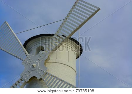 Windmill - lighthouse on the breakwater at the entrance to the harbor - Swinoujscie poster