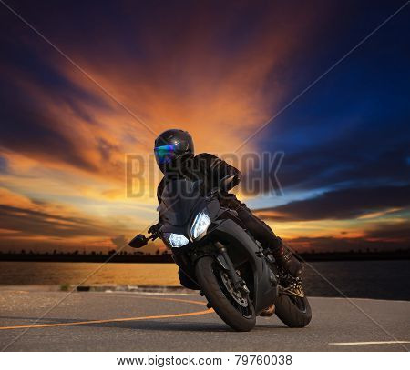 Young Man Riding Big Bike Motorcycle Leaning Curve On Asphalt Highways Road Against Beautiful Dusky