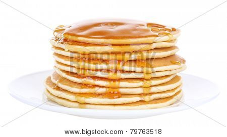 Stack of delicious pancakes with honey on plate isolated on white