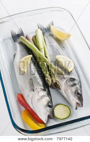 Fresh raw sea bass with vegetables close up poster