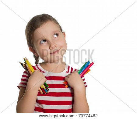Cute Little Girl Holding Colourful Pencils And Markers Looking Up Imagining Ideas