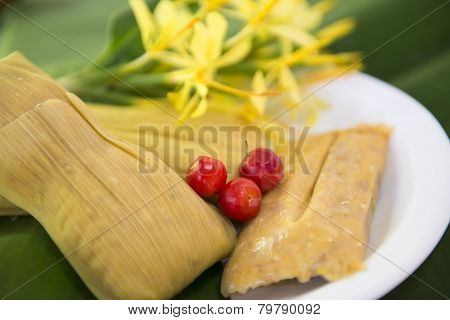 Cuban cuisine: traditional homemade tamal a popular Latin American dish which takes lot of hard work to prepare poster