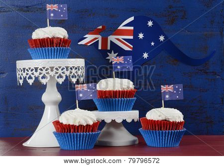 Happy Australia Day January 26 Party Food With Red Velvet Cupcakes With Kangaroo Flag On Dark Red An