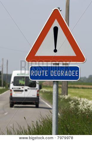 Damaged road warning sign