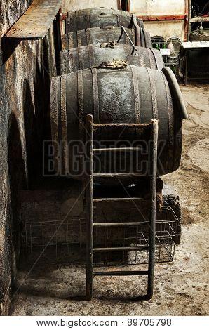 Ladder Against An Oak Wine Barrel