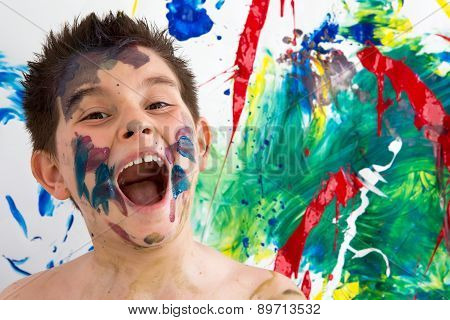 Funny Little Boy With Paint Splodges On His Face