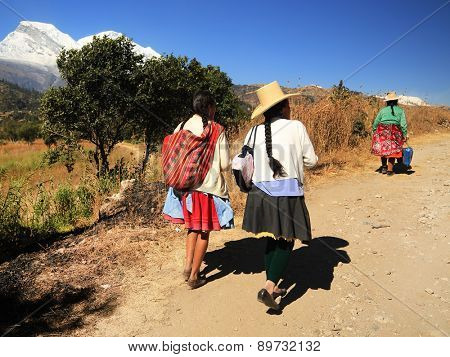 YUNGAY, PERU - AUGUST 23: Peruvian peasant women returning from the market of Huaraz, Peru South America, August 23 2012