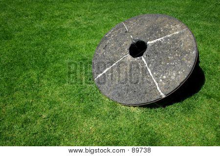 Millstone On Grass