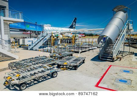 Avianca ground support equipment dollies and stairs at international airport el Dorado in Bogota Col