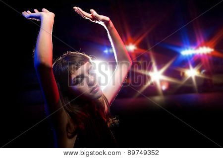 young drug intoxicated female holding her hands up while being arrested poster