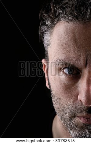 Portrait of a sceptical man on a black background