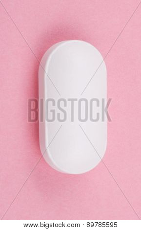 White Pill On Pink Background