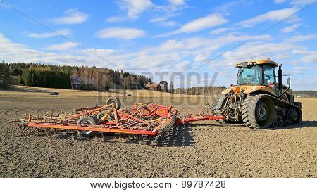 Challenger MT765C Tracked Tractor And Cultivator On Field