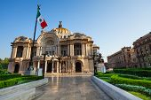 Palace of fine arts facade and Mexican flag on downtown of Mexico capital city poster