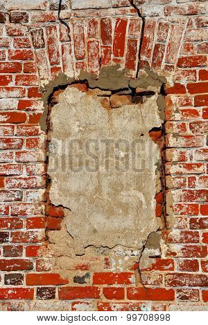 Wall Of Old Orange Shabby Bricks With Concreted Window Opening