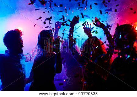 Dancing people at nightclub on Halloween night poster
