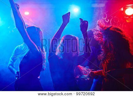 Girlfriends dancing at disco in nightclub poster