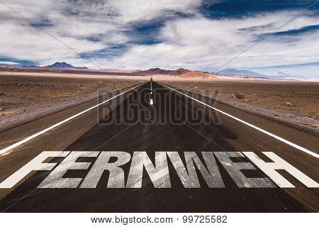 Wanderlust (in German) written on desert road