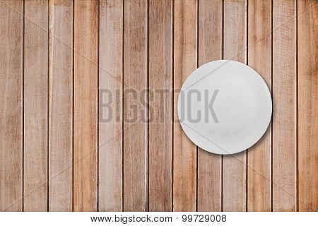 white dishes on a wooden table, top view