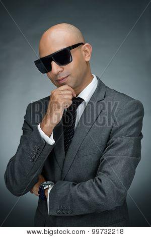 Portrait of stylish bodyguard isolated on black poster