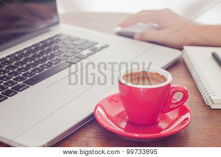 Red Coffee Cup With Notepad And Laptop