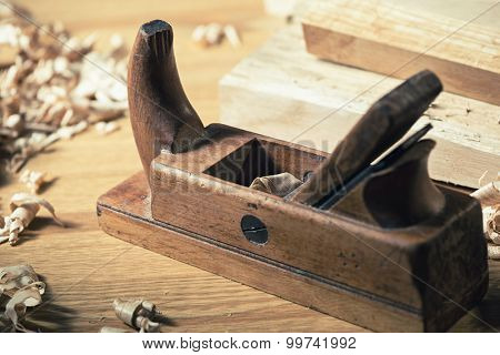 Old wooden hand plane for woodworking and carpentry. poster
