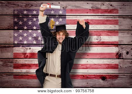 Male student in graduate robe jumping against composite image of usa national flag
