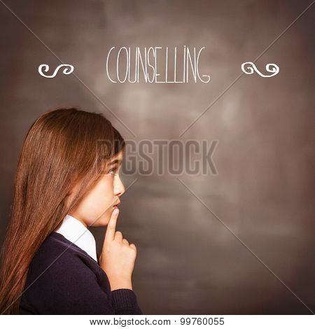 The word counselling against cute pupil looking a chalkboard