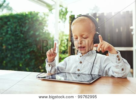Little Boy Immersed In His Music