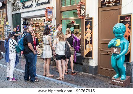 Tourists Queuing For Traditional Belgian Waffles