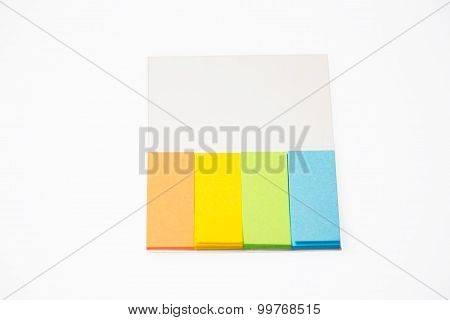 photo of colorful notepads on white background