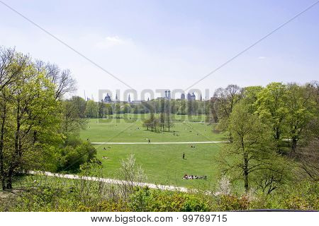 a photo of the english garden in spring in munich