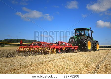 John Deere 8370R Tractor And Vaderstad Opus 400 Cultivator On Field