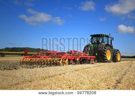 John Deere 8370R Tractor And Vaderstad Opus 400 Cultivator On Field