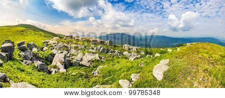 Stones In Valley On Top Of Mountain Range At Sunrise