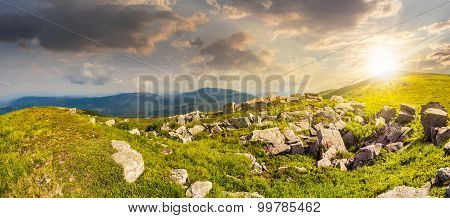 Stones In Valley On Top Of Mountain Range At Sunset