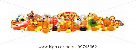 Pile of Halloween candy over white