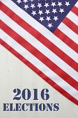 USA 2016 Presidential Election with American Stars and Stripes flag on wood background with added text. poster