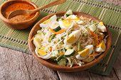 Gado Gado Indonesian vegetable salad close-up on the table. horizontal poster