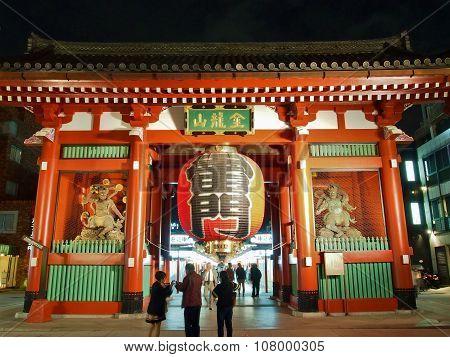 Tourists visit Kaminarimon - entrance gate of Senso-ji Temple in Asakusa, Tokyo, Japan.
