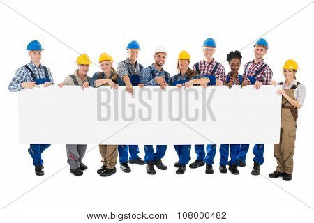 Happy Construction Workers Holding Blank Billboard