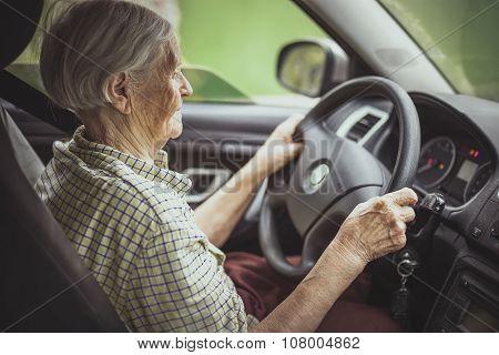 Senior woman driving a car.