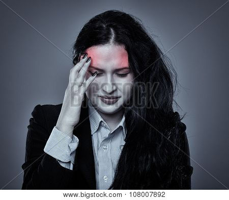 Businesswoman With Strong Headache