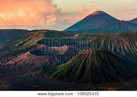 Group of volcanoes in the National Park of Java island, Indonesia. Bromo (smoking), Batok, Semeru volcanoes