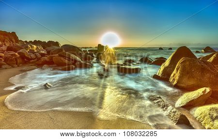 Limitless waves at sunrise on the rocks Binh Thuan