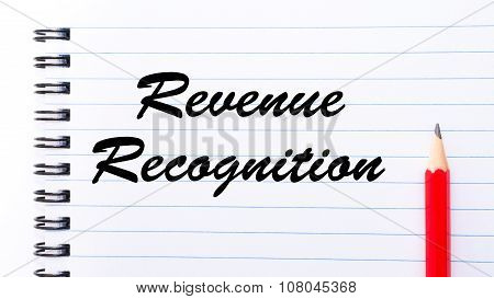 Revenue Recognition written on notebook page red pencil on the right. Motivational Concept image poster