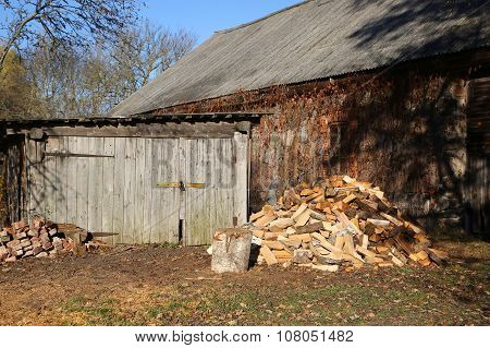 Wooden Barn And Chopped Firewood